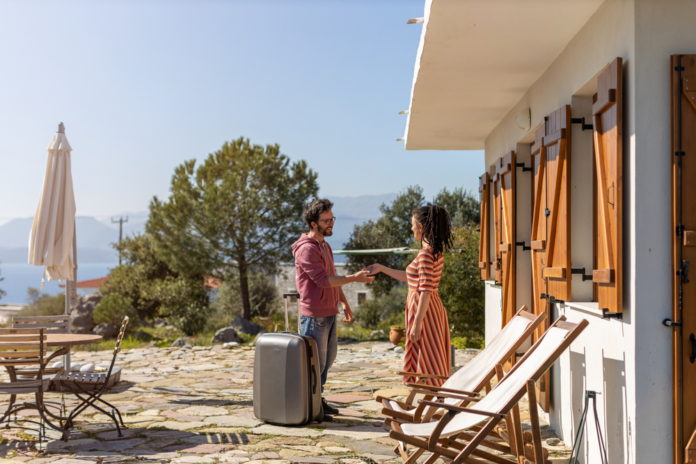Couple arriving at holiday home